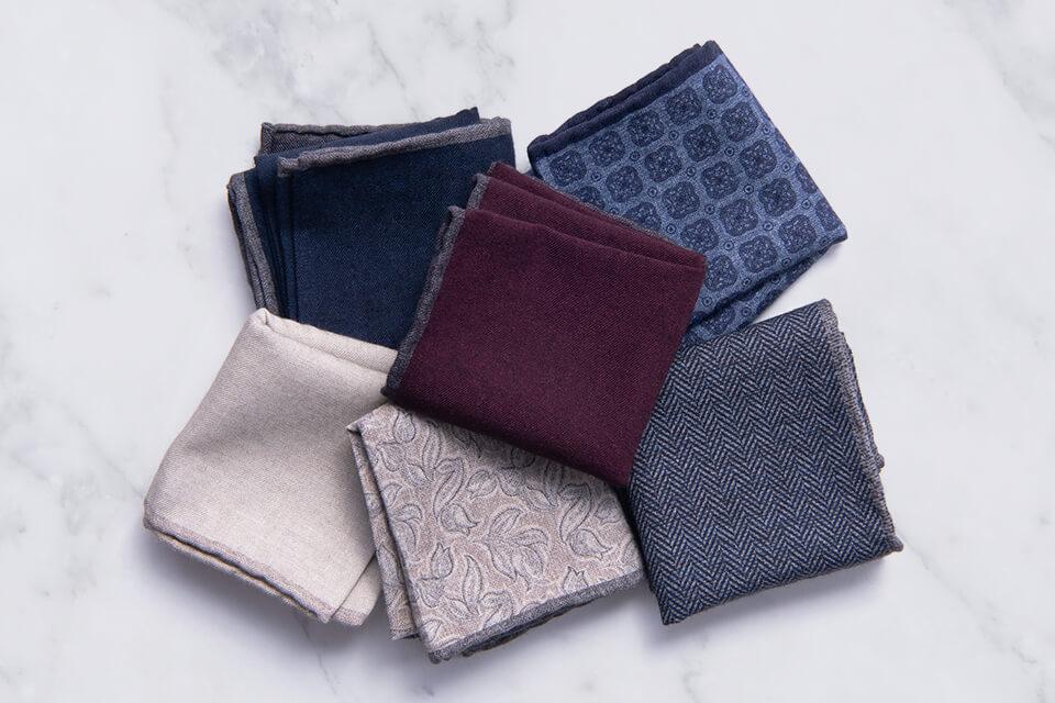 Italian Pocket Squares folded on marble surface