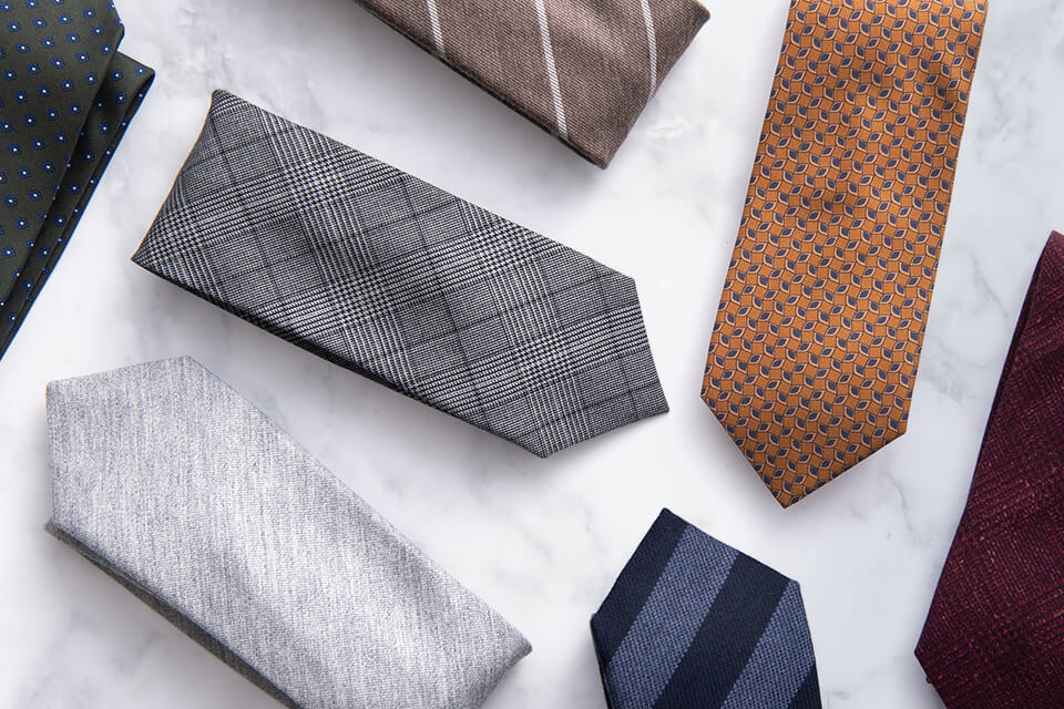 Premium Ties and neckwear on marble surface