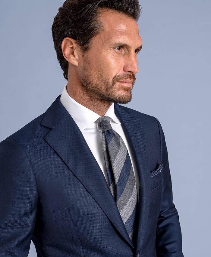 Navy and Grey Multi Stripe Wool and Silk Tie shown with Suit Jacket
