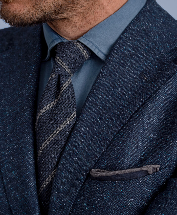 Blue and Grey Silk and Wool Grenadine Striped Tie shown with Suit Jacket