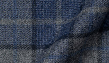 Fabric swatch of Canclini Grey and Navy Plaid Beacon Flannel Fabric