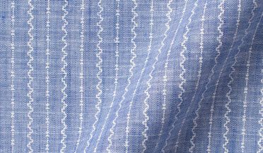 Fabric swatch of Albini Step Stripe Print Chambray Fabric