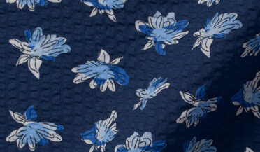 Fabric swatch of Canclini Navy Seersucker Floral Print Fabric