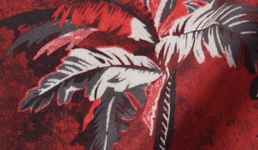 Fabric swatch of Albini Red Palm Tree Print Tencel Fabric