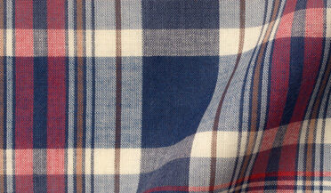 Fabric swatch of Red Navy and Ecru Indian Madras Fabric